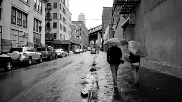 Couple walking through Brooklyn in the rain