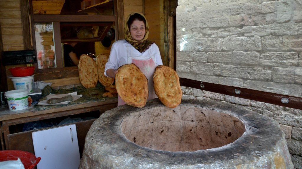 Baku Azerbaijan Old City bread woman