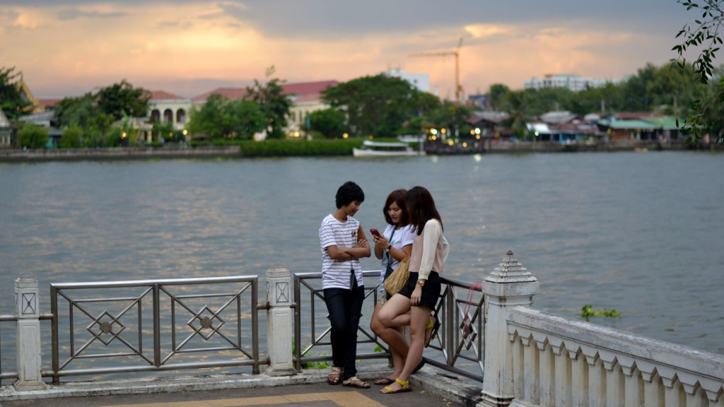 Bangkok Thailand people down by the river at sunset